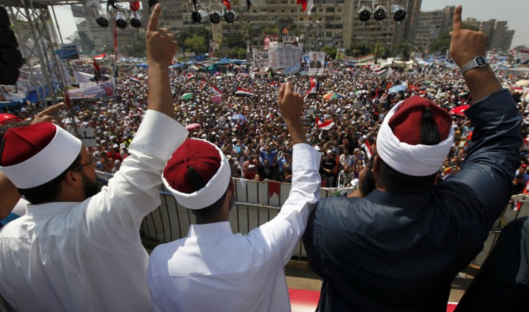 Clerics supporting deposed Egyptian President Mohamed Mursi attend a rally at the Raba El-Adwyia square where Mursi's supporters are camping, in Cairo August 2, 2013. (Mohamed Abd El Ghany/Reuters)