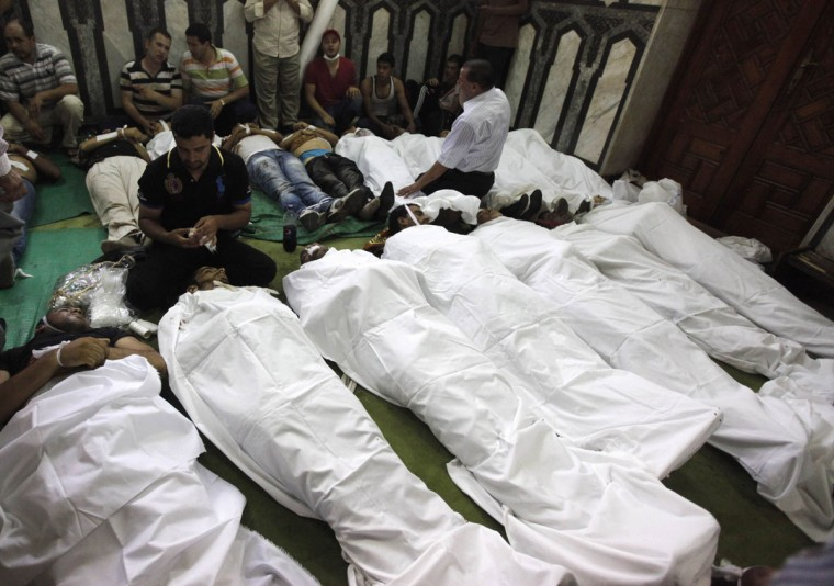 "Bodies of protesters who support ousted Egyptian President Mohamed Morsi, killed during clashes, are seen inside a mosque in Ramses Square in Cairo, August 16, 2013. Protests by supporters of ousted Islamist President Mohamed Morsi turned violent across Egypt on Friday, with witnesses reporting four dead in central Cairo and at least 12 killed in northern cities as the Muslim Brotherhood staged a ""Day of Rage."" (Mohamed Abd El Ghany/Reuters)"