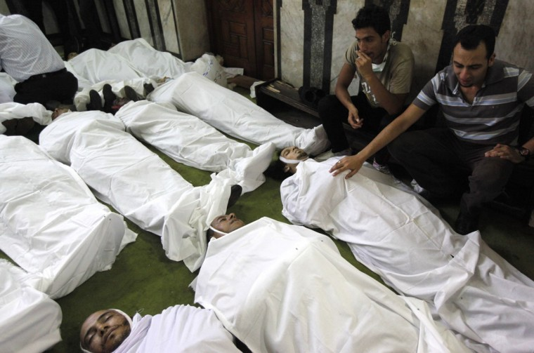 """Bodies of protesters who supported ousted Egyptian President Mohamed Morsi and were killed during clashes lie inside a mosque in Ramses Square in Cairo, August 16, 2013. Protests by supporters of Morsi turned violent across Egypt on Friday, with witnesses reporting four dead in central Cairo and at least 12 killed in northern cities as the Muslim Brotherhood staged a """"Day of Rage."""" (Mohamed Abd El Ghany/Reuters)"""