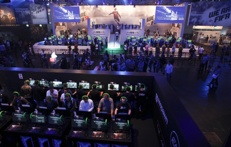 An overview shows the Electronic Arts EA exhibition stand during the Gamescom 2013 fair in Cologne August 21, 2013. The Gamescom convention, Europe's largest video games trade fair, runs from August 22 to August 25. (Ina Fassbender/Reuters)