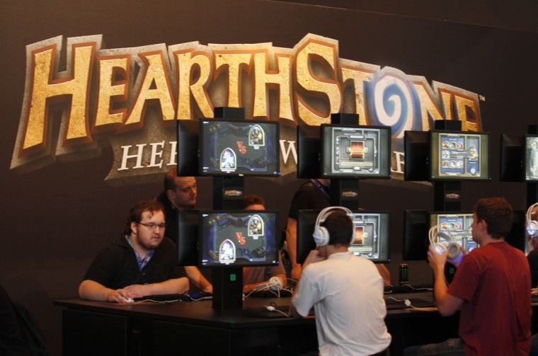 "Visitors play ""Hearthstone"" at the World of Warcraft exhibition stand during the Gamescom 2013 fair. (Ina Fassbender/Reuters)"