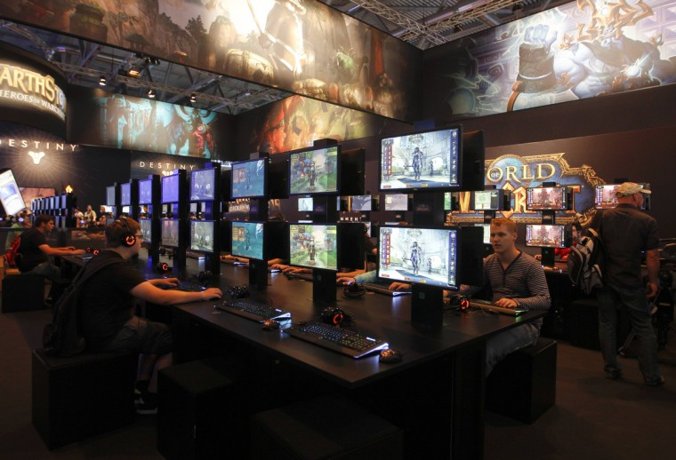 "Visitors play ""World of Warcraft"" during the Gamescom 2013 fair in Cologne. (Ina Fassbender/Reuters)"