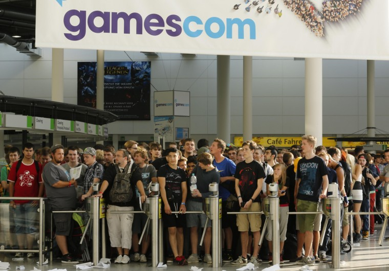 Visitors wait before the opening of the Gamescom 2013 fair in Cologne. (Ina Fassbender/Reuters photo)