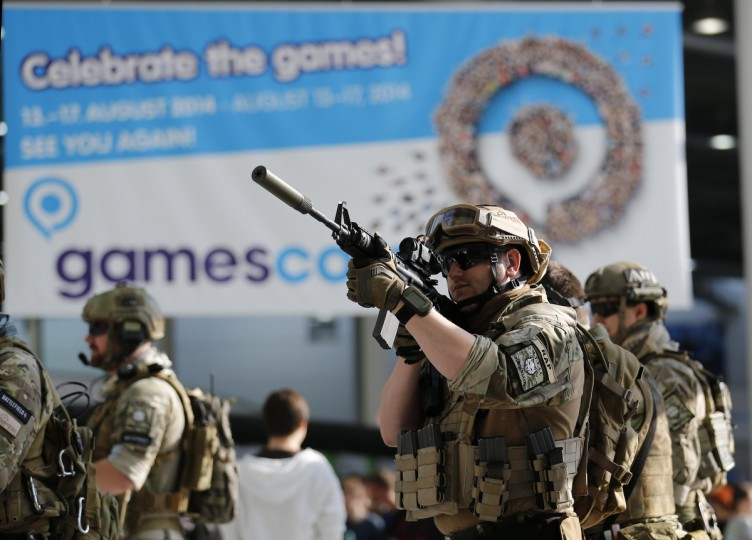 Men dressed as soldiers pose before the opening of the Gamescom 2013 fair in Cologne. (Ina Fassbender/Reuters photo)