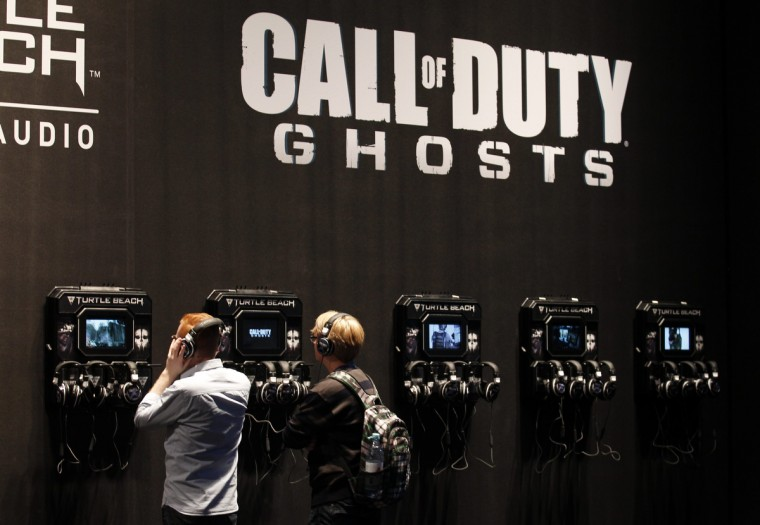 Visitors at the Call of Duty exhibition stand during the Gamescom 2013 fair in Cologne. (Ina Fassbender/Reuters)