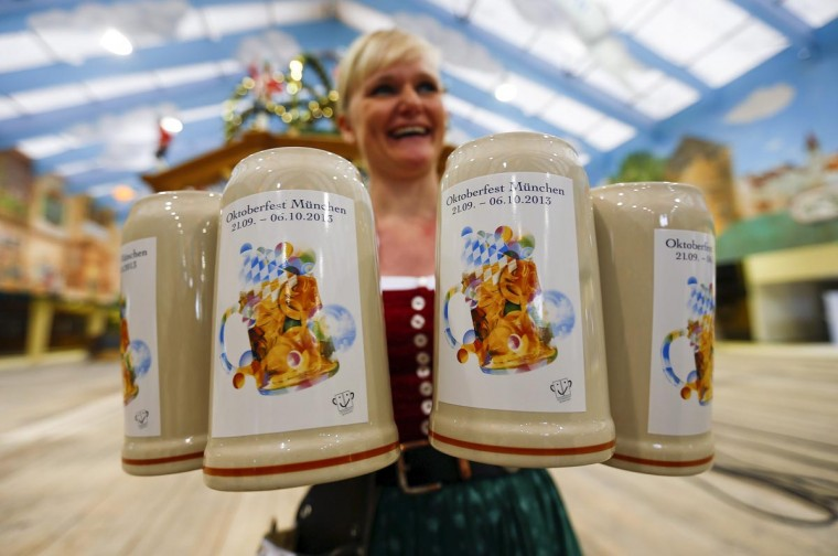 A waitress presents the official Oktoberfest beer mug during a presentation in Munich August 27, 2013. The Oktoberfest, the world's biggest beer festival, runs from September 21 until October 6 this year. (Michael Dalder/Reuters)