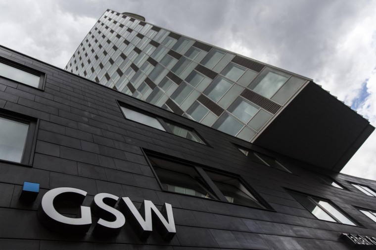 The logo of the GSW property firm is seen at its headquarters in Berlin, August 20, 2013. Deutsche Wohnen offered to buy rival property group GSW Immobilien for 1.75 billion euros ($2.3 billion) to expand in Berlin's booming real-estate market, as a tentative pick-up in Europe's economy attracts international investors. (Thomas Peter/Reuters)