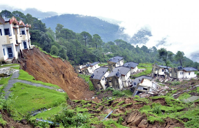 Damaged residential houses of the Indian army are seen after a landslide caused by heavy rains in Tihra Lines near the northern Indian hill town of Dharamsala. (Reuters)