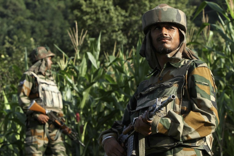 Indian army soldiers patrol near the Line of Control, a ceasefire line dividing Kashmir between India and Pakistan, in Poonch district . India's parliament was paralyzed on Wednesday as opposition lawmakers angrily protested over the government's response to an ambush in which five soldiers were shot dead on the border with Pakistan in the disputed region of Kashmir. (Mukesh Gupta/Reuters)