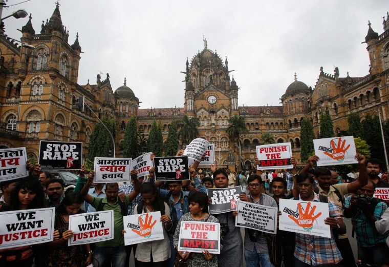 Journalists hold placards as they participate in a protest march against the rape of a photo journalist by five men inside an abandoned textile in Mumbai. The attack on Thursday night triggered protests and an outcry on social media, with many users shocked that it took place in Mumbai, which is widely considered to be India's safest city for women. (Danish Siddiqui / Reuters)