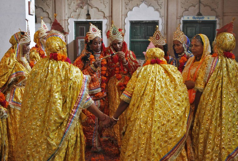 Widows dressed as the Hindu god Krishna's consort, Radha, dance during celebrations to mark Janmashtami festival at the Meera Sahavagini ashram in Vrindavan, located in the northern Indian state of Uttar Pradesh. Most of the widows who live in this ashram have been abandoned by their families. The festival, which marks the birth anniversary of Lord Krishna, is celebrated across India Wednesday. (Anindito Mukherjee/Reuters)