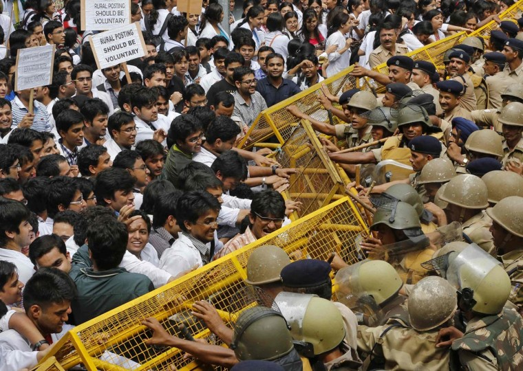 Indian medical students push barricades installed by police during a protest in New Delhi August 8, 2013. Hundreds of medical students on Thursday protested against the compulsory year-long rural posting required by the Indian government, demanding it be made voluntary, local media reported. (Adnan Abidi/Reuters)