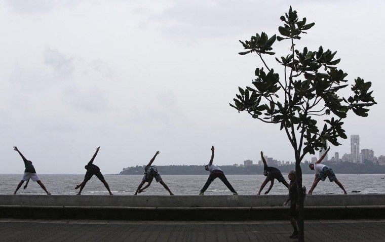 Men exercise on a sea wall along the Arabian Sea in Mumbai August 20, 2013. (Danish Siddiqui/Reuters)