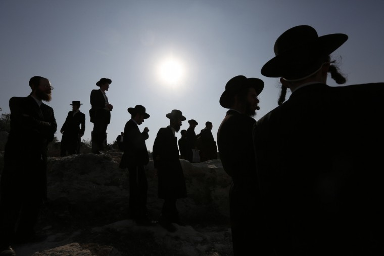Ultra-Orthodox protesters pray during clashes in the town of Beit Shemesh, near Jerusalem. Ultra-Orthodox protesters clashed on Wednesday with police and other security forces in the town of Beit Shemesh after a group of them broke into a construction site to prevent work from taking place at the site they believe contains ancient graves. (Baz Ratner/Reuters)