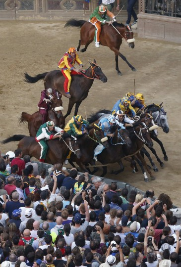 Jockeys of the ten parishes are seen at the start of the Palio of Siena horse race August 16, 2013. (Stefano Rellandini/Reuters)