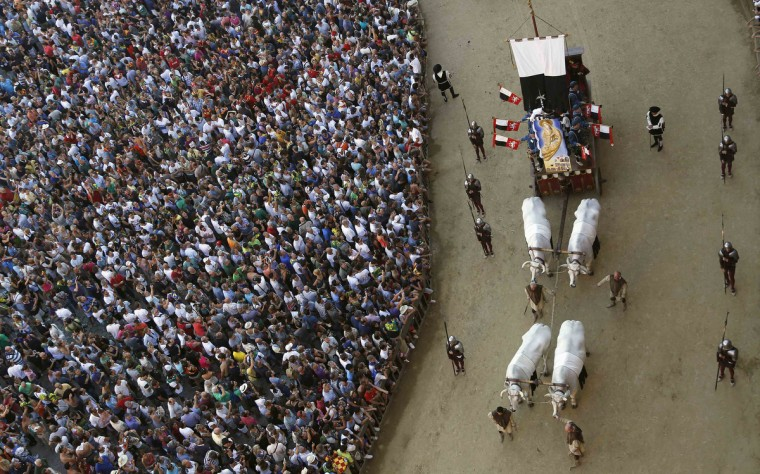 "The ""Cencio"" is carried during a historical parade before the Palio of Siena horse race August 16, 2013. (Stefano Rellandini/Reuters)"