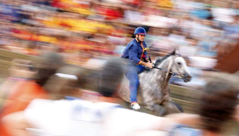 Jockey Luigi Bruschelli of the Nicchio (Shell) parish competes during the fourth of six trial horse races in Del Campo square in Siena. (Stefano Rellandini/Reuters photo)