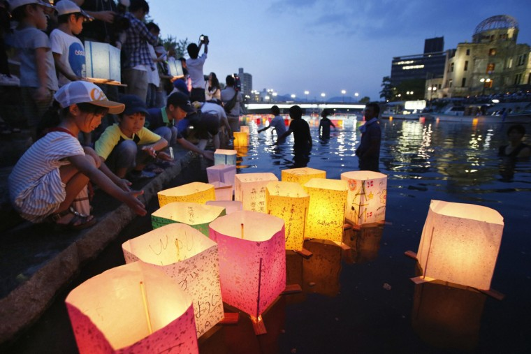 People release paper lanterns on the Motoyasu river facing the gutted Atomic Bomb Dome in remembrance of atomic bomb victims on the 68th anniversary of the bombing of Hiroshima, in this photo taken by Kyodo. (Kyodo/Reuters)