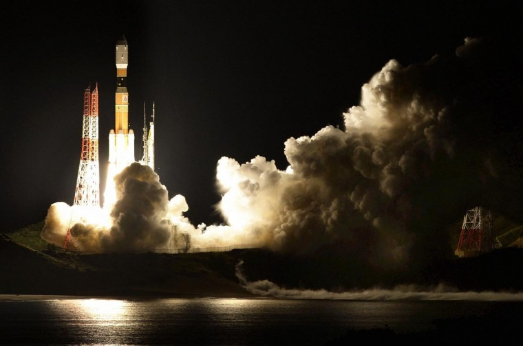 "A H-2B rocket carrying cargo for the International Space Station blasts off from the launching pad at Tanegashima Space Center on the Japanese southwestern island of Tanegashima, about 621 miles southwest of Tokyo, in this photo taken August 4, 2013. The rocket, also known as ""Kounotori,"" is carrying a small robot that will help Japanese astronaut Koichi Wakata conduct experiments in space. Wakata will join the Space Station later this year. (Kyodo via Reuters)"