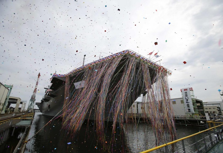 Japan Maritime Self-Defense Force's helicopter destroyer DDH183 Izumo, the largest surface combatant of the Japanese navy, is seen during its launching ceremony in Yokohama, south of Tokyo August 6, 2013. (Toru Hanai/Reuters)