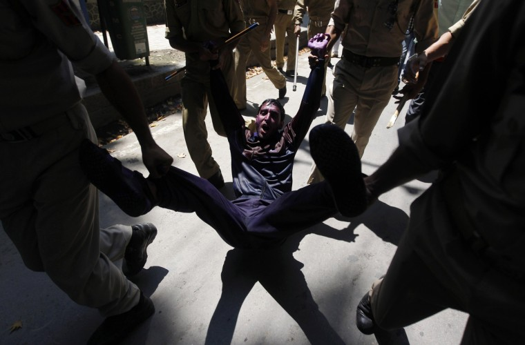 Indian police detain a government employee during a demonstration in Srinagar. Indian police in Srinagar detained dozens of protesting government employees as they attempted to reach the residence of Kashmir's chief minister Omar Abdullah to demand their long pending arrears and an increase in retirement age, said the protesters. (Danish Ismail/Reuters photo)