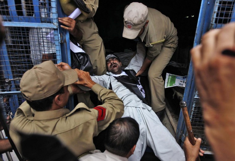 Indian policemen detain an activist of the Forum for Justice to Enforced Disappeared Persons (FJEDP) during a protest in Srinagar August 20, 2013. Dozens of activists on Tuesday appealed to the international community to press the Indian government to disclose whereabouts of their family members who disappeared in the custody of Indian security forces and other agencies, according to a media release from the FJEDP. (Danish Ismail/Reuters)