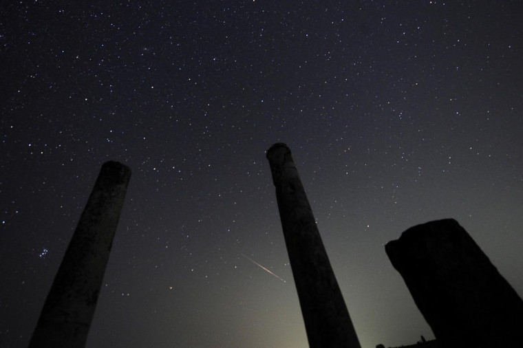A meteor streaks over the northern skies during the Perseid meteor shower at Stobi archeological site, which was the largest city in the northern part of the Roman province Macedonia and later capital city of the Roman province Macedonia Secunda, early August 13, 2013. According to NASA, the annual Perseid meteor shower reaches its peak on August 12 and 13 in Europe. The fireballs from the meteorites are fast and plentiful, the agency adds, with as many as 100 visible in a single hour. (Ognen Teofilovski/Reuters)