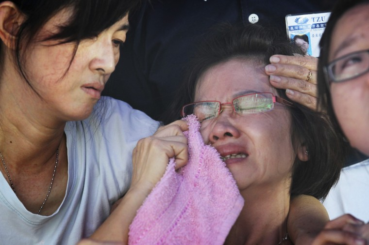 Family members of a victim in Wednesday's Genting Highlands bus crash cry at a hospital mortuary in Kuala Lumpur. A bus traveling from the Malaysian hilltop gambling resort of Genting Highlands to the capital Kuala Lumpur plunged 200 feet into a ravine killing as many as 32 people, officials said. (Stringer/Reuters photo)
