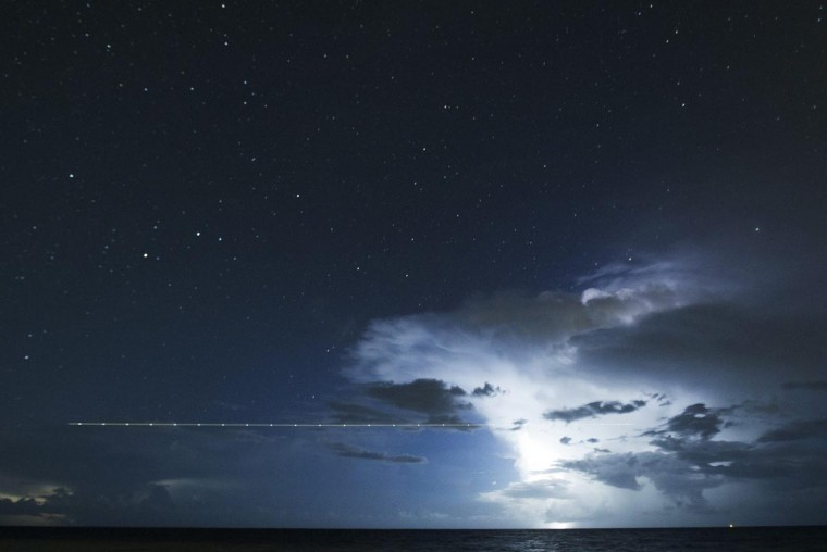 A long exposure shot shows a plane flying over the sea during a lightning storm on the last day of the annual Perseid meteor shower, near the popular tourist destination of Cancun, August 12, 2013. Picture taken August 12, 2013. (Victor Ruiz Garcia/Reuters)