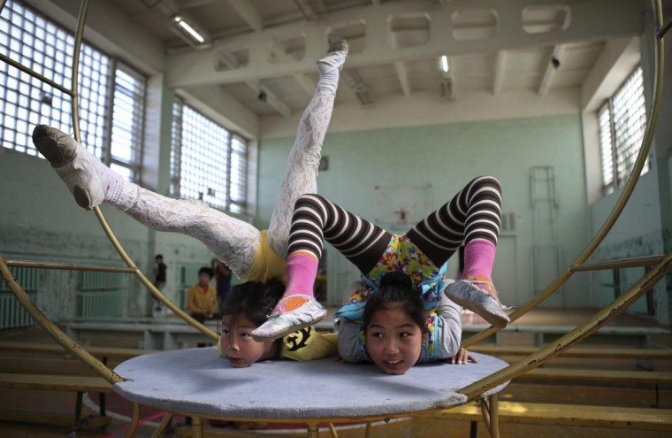 Members of Shonkhoodoi Circus practice in a gymnasium in Darkhan August 23, 2013. Mission Manduhai was created by Chimgee Haltarhuu, a former Mongolian gymnast and victim of domestic abuse, who brought three U.S. students and six young performers from the Shonkhoodoi Circus in Darkhan to travel through the Mongolian countryside to give free circus performances. (Mareike Guensche/Reuters)
