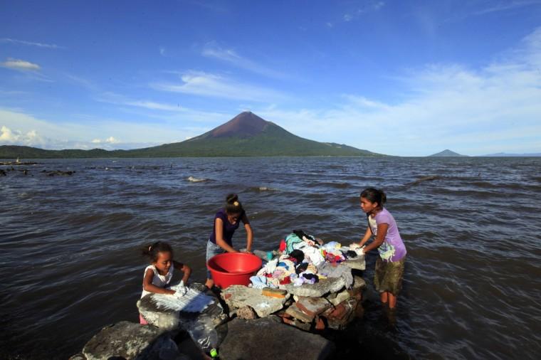 Women wash clothes in Lake Managua in Momotombo town. (Oswaldo Rivas/Reuters photo)