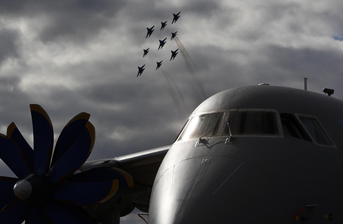 August 27 Photo Brief: Napolitano's farewell speech, Syrian refugees, a Russian airshow