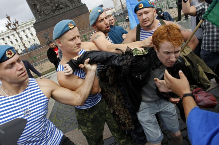 Former Russian paratroopers shove gay rights activist Kirill Kalugin aside to stop his one-man protest against LGBT rights violations in St. Petersburg, August 2, 2013. The former servicemen were gathered in central St. Petersburg to celebrate Russian Paratroopers Day, an annual holiday for the Russian airborne troops celebrated since the Soviet era days. (Alexander Demianchuk/Reuters)