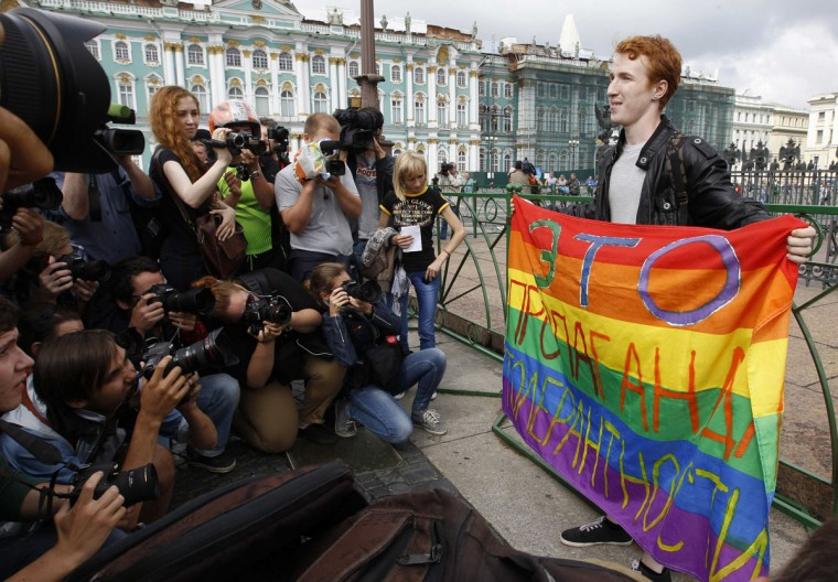 "Gay rights activist Kirill Kalugin poses for press during a one-man protest in St. Petersburg, August 2, 2013. The banner reads, ""This is propagating tolerance."" (Alexander Demianchuk/Reuters)"