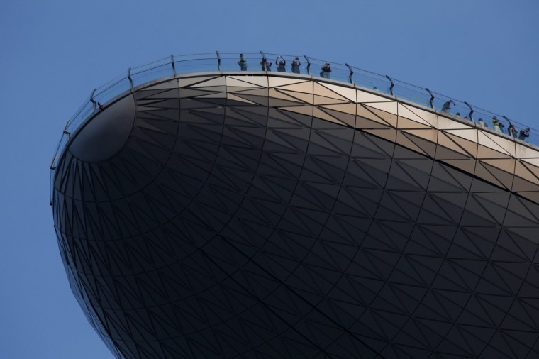 Visitors take photos on the observation deck of the Marina Bay Sands Skypark in Singapore. (Edgar Su/Reuters photo)
