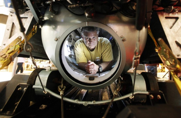 "Ocean environmentalist Scott Cassell of the U.S. poses in his homebuilt submersible ""The Great White"" in Singapore August 29, 2013. Cassell says his submersible runs entirely on electricity and is homebuilt from mostly recycled materials. The two-man craft can deep dive to the depth of 574 feet and will be deployed on a marine study trip in the waters of Malaysia. (Edgar Su/Reuters)"