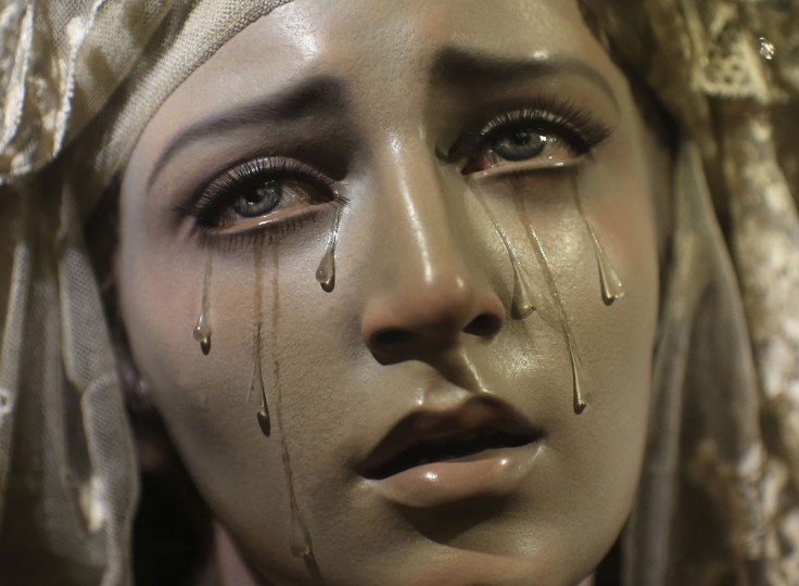 """A wooden carving of """"Virgen de los siete dolores y Madre de todos los que lloran"""" (Virgin of the Seven Sorrows and Mother of all those who cry) by Spanish artist Francisco Romero Zafra, is displayed in a church in the Andalusian capital of Seville, southern Spain on August 9, 2013. (Marcelo del Pozo/Reuters)"""