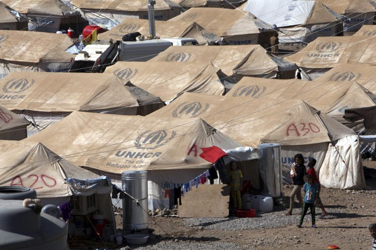 Syrian refugees, who fled the violence in Syria, take shelter at a new refugee camp in the outskirts of the city of Arbil in Iraq's Kurdistan region August 26, 2013. (Azad Lashkari/Reuters)
