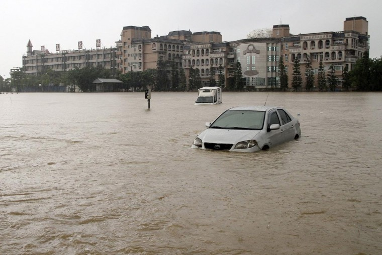 Vehicles are seen partially submerged in floodwaters caused by Tropical Storm Kong-rey in Chiayi county, southern Taiwan August 29, 2013. (Stringer/Reuters)