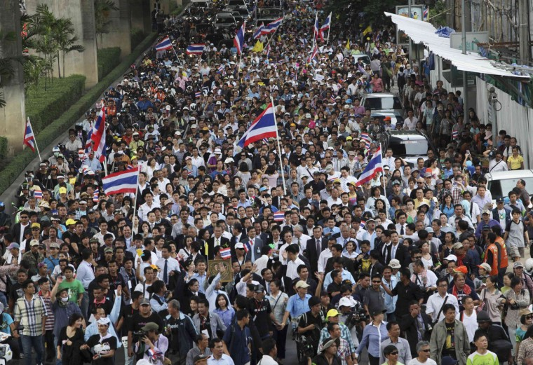 Anti-government protesters march to parliament in Bangkok. Thailand's parliament was due to debate a political amnesty bill on Wednesday as anti-government protesters marched to try to get it scrapped, saying it could let ex-premier Thaksin Shinawatra return from exile without having to serve a jail sentence. (Kerek Wongsa/Reuters)