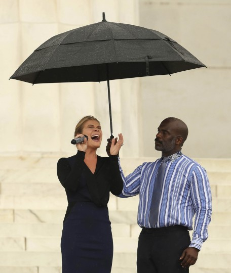 """Singer LeAnn Rimes (L) performs during the 50th anniversary of the """"March on Washington"""" at the Lincoln Memorial in Washington August 28, 2013. Words from the first black U.S. president and bell ringing around the world on Wednesday will mark 50 years to the minute that civil rights leader Martin Luther King ended his landmark """"I have a dream"""" speech. (Gary Cameron/Reuters)"""