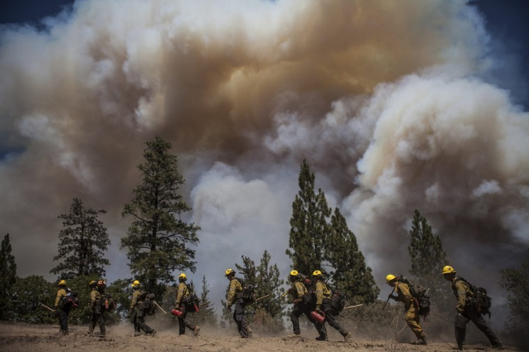 Los Angeles County firefighters hike in on a fire line on the Rim Fire near Groveland, California, August 22, 2013. The wildfire raging out of control near Yosemite National Park in northern California ballooned to nearly 54,000 acres on Thursday, more than tripling in size from the day before, forest officials said. (Max Whittaker/Reuters)