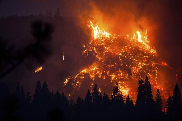 The Rim Fire burns near Buck Meadows, California, August 24, 2013. A fast-moving wildfire on the edge of Yosemite National Park has forced the closure of two more areas of the park, but an official said on Saturday he was cautiously optimistic that firefighters could halt the advance of flames. The fire, which had grown to just over 125,000 acres (50,585 hectares) as of early Saturday, remained largely unchecked with extreme terrain hampering efforts at containment, which stood at 5 percent. (Max Whittaker/Reuters)