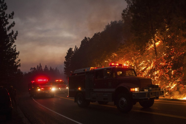 Fire trucks drive along Highway 120 while fighting the Rim Fire near Buck Meadows, California, August 24, 2013. (Max Whittaker/Reuters)
