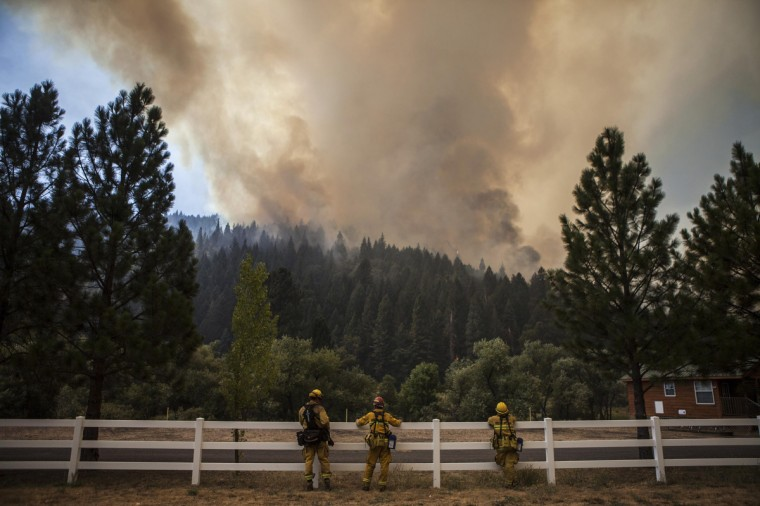 Firefighters monitor the edge of the Rim Fire as it burns near Berkeley Camp near Buck Meadows, California, August 23, 2013. The 105,000-acre Rim Fire, named for a Stanislaus National Forest lookout point called Rim of the World, has destroyed four homes and 12 outbuildings since it broke out on Saturday. It had blackened 11,000 acres at the northeastern edge of Yosemite as of Friday, park spokeswoman Kari Cobb said. (Max Whittaker/Reuters)