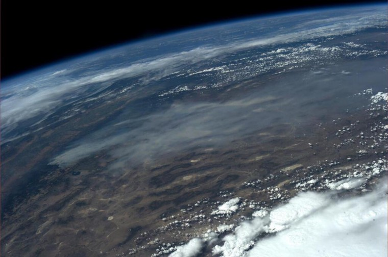 A NASA photo from the International Space Station taken by astronaut Karen L. Nyberg shows wildfires near Yosemite National Park in this image tweeted on August 24, 2013.(NASA/Handout via Reuters)