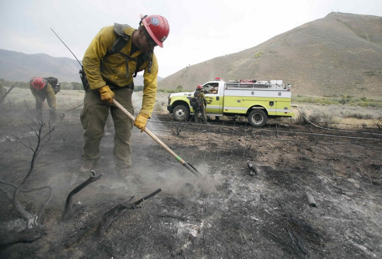 Firefighters clear a burned area at the Beaver Creek wildfire outside Hailey, Idaho August 17, 2013. A wildfire raging across the central mountains of Idaho forced the evacuation of 200 homes in the tourist town of Hailey on Saturday as fire-fighters lost ground against a blaze threatening the nearby international ski destination of Sun Valley. (Jim Urquhart/Reuters)