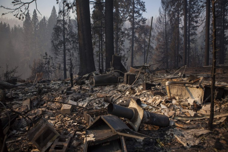 The remains of a burned home from the Rim Fire near Buck Meadows, California, August 23, 2013. (Max Whittaker/Reuters)