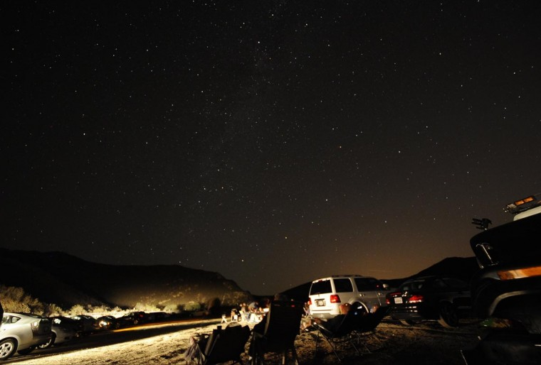 Stargazers come out to watch the Perseid meteor shower early on Monday morning north of Castaic Lake, California August 12, 2013. According to NASA, the Perseid meteor shower, which is an annual event, reaches its peak on August 11 and 12. The fireballs from the meteorites are fast and plentiful, the agency adds, with as many as 100 visible in a single hour. (Gene Blevins/Reuters)