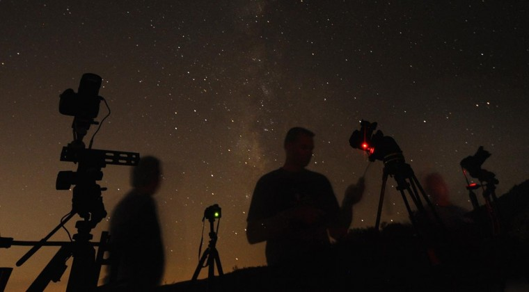 (L-R) Los Angeles photographers Shawn Kaye, Scott Meadows and Steve Gentry set their cameras pointed to the stars during the Perseid meteor shower early on Monday morning north of Castaic Lake, California August 12, 2013. According to NASA, the Perseid meteor shower, which is an annual event, reaches its peak on August 11 and 12. The fireballs from the meteorites are fast and plentiful, the agency adds, with as many as 100 visible in a single hour. (Gene Blevins/Reuters)